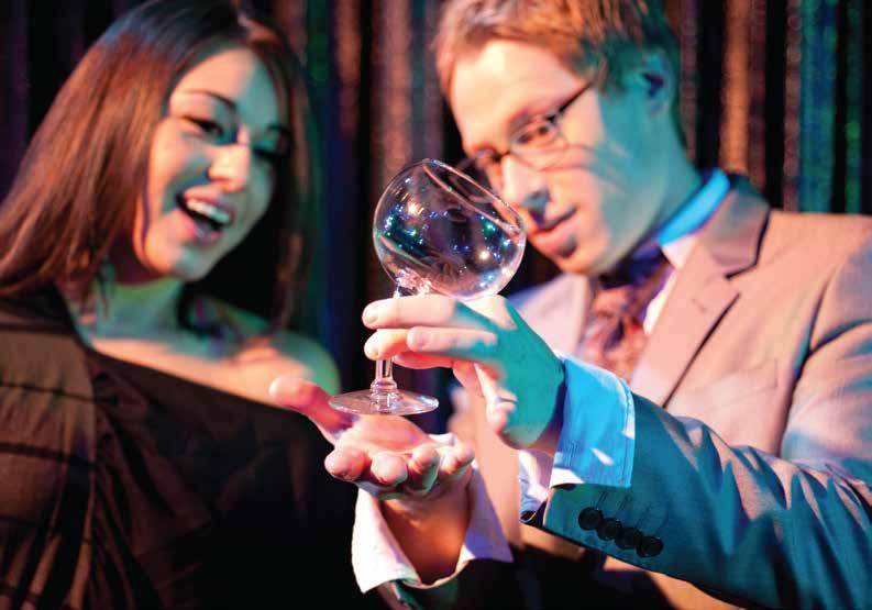 Ben Seidman bending a wine glass magic trick
